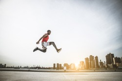 Sportive man training outdoors - Runner jogging, healthy lifestyle and sport concept