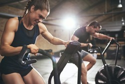 Sportive people while cardio training in gym. Horizontal indoors shot