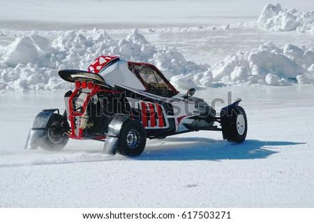 Sportive vehicle drifting on snowy terrain. Kart Cross on Ice.