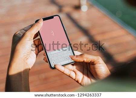 Sportive woman texting on her phone