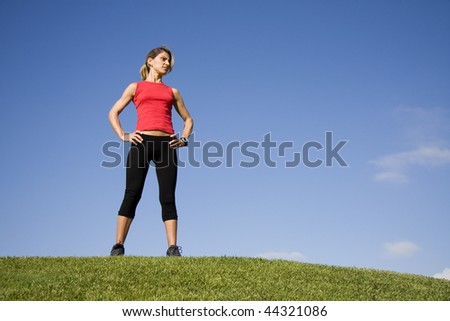 Sportive young woman looking around after exercise