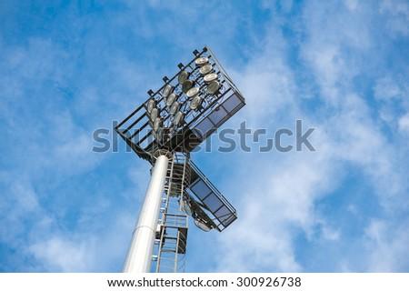 Sportlight at stadium on blue sky clouds background