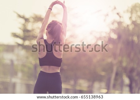 Sports and activities concept. Woman exercising stretching outdoor. - Shutterstock ID 655138963