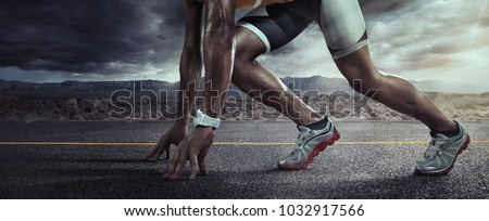 Sports background. Runner feet running on road closeup on shoe. Start line