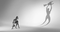 Sports background. Runner on the start. Black and white image isolated on white with long shadow of the winner.