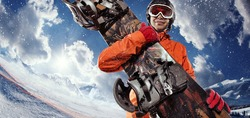 Sports background. Snowboard and snowboarder. Extreme winter sport. Fish eye.