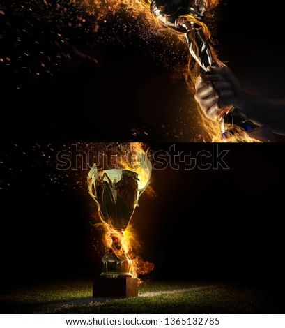 Sports background. Sport collage with fire and energy. Man's hand holding up trophy goblet. Winner in a competition.  #1365132785