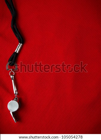 Sports background with referee whistle on red jersey