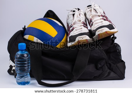 Sports bag with the volleyball ball  and men\'s sneakers.