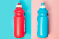 Sports bottles isolated on colorful and bright background. Sport, fitness, healthy lifestyle and objects concept