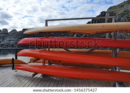 Sports canoes on the pier.