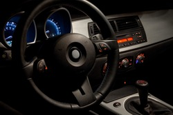 Sports car interior with dramatic night time lighting