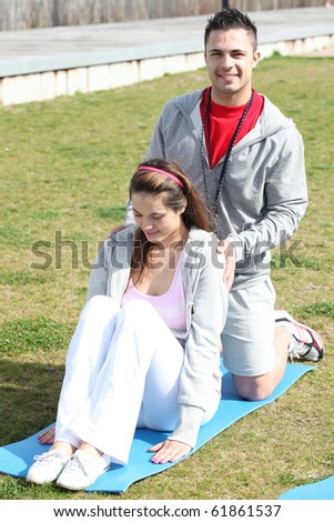 Sports coach and young woman