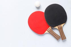 sports composition. Ping pong close-up. rackets for playing on a blue background