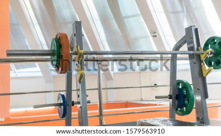 sports equipment and barbells in the gym