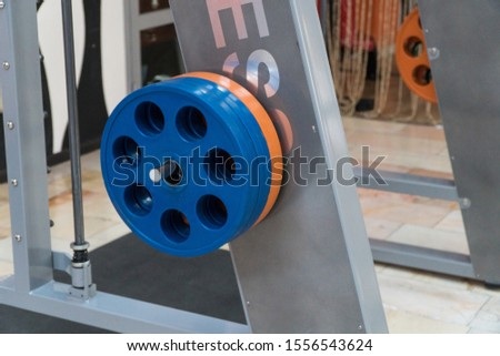 sports equipment and barbells in the gym, close-up