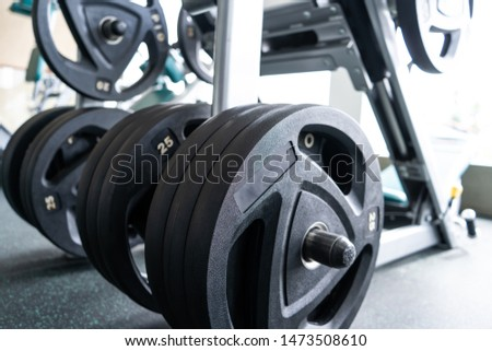 Sports equipment in gym. Barbells of different weight on rack,close up