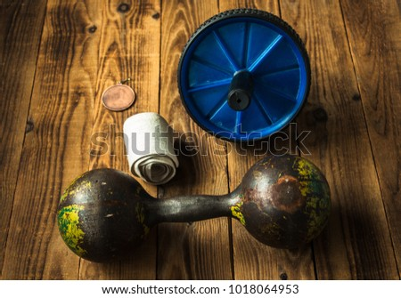 sports equipment retro on a wooden bacground #1018064953