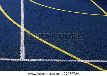 Sports field with synthetic turf and different markings, used in sports.Detail