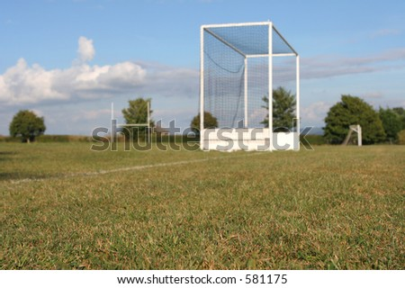 Sports fields with soccer, hockey and rugby posts __ selective focus on foreground turf. - stock photo