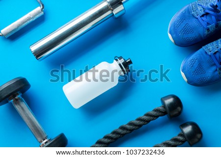 Sports Fitness concepts with Gym equipment on blue background