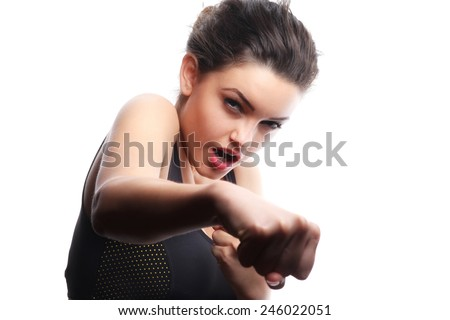 Sports girl, studio shot. isolated over white background.Sexy young and fit female fighter posing in combat poses