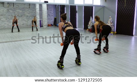 Sports girls with orange dumbbells. The concept of sport and recreation #1291272505