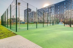 Sports ground in courtyard of residential complex. Public sports grounds for team games of sport, basketball, football, volleyball, handball in residential area, of educational institutions city
