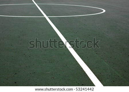 Sports image of lines on a weathered basketball court