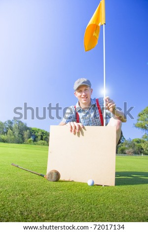 Sports Man Standing Behind A Golf Course Hole Flag Pole While Holding A Blank Banner Board With A Message Of A Win In The Form A Of A Golf Victory Banner