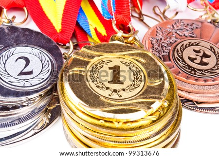 Sports medal in the stacks. Photo Closeup