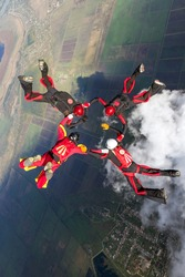 Sports parachutist build a figure in free fall. Extreme sport concept.