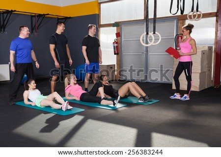 Sports people preparing for exercise and looking at coach
