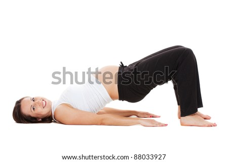 sports pregnant woman doing gymnastic. isolated on white background