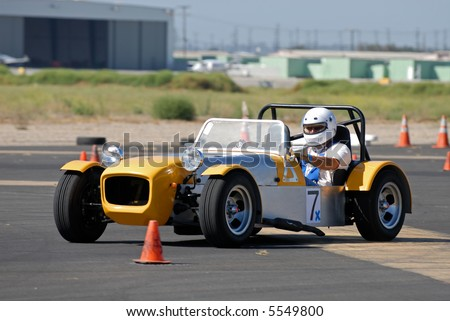 Sports racing car competing in auto cross race at Oxnard, California airport