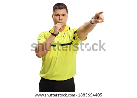 Sports referee blowing a whistle and pointing with finger isolated on white background