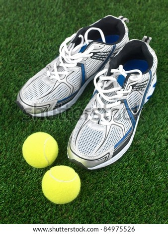 Sports runners situated on artificial turf