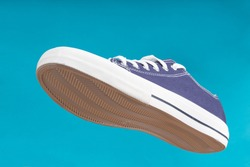 Sports shoe on blue background. Sneaker or trainer. Fitness, sport, training concept.