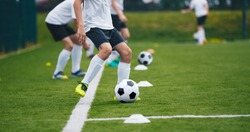 Sports Soccer Players on Training. Boys Kicking Soccer Balls on Practice Session. Kids Playing Soccer on Training Football Pitch. Beginner Soccer Drills for Juniors