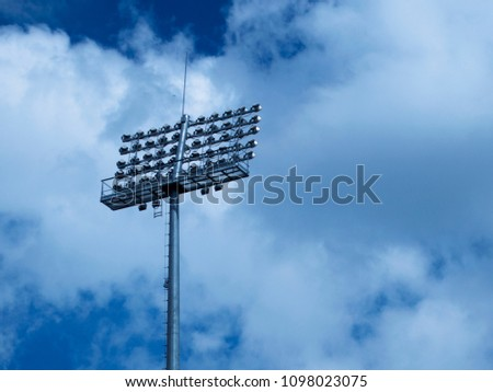 Sports Spotlight on a sky background with clouds #1098023075