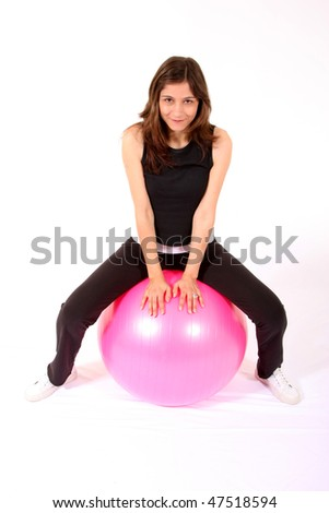 sports woman gym width pink ball - stock photo