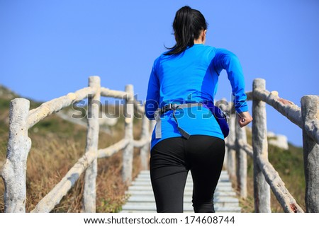 sports woman running climbing mountain stairs