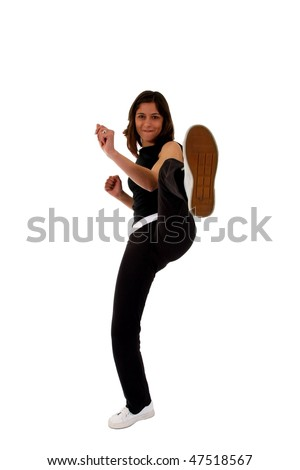 Sports Woman training a high kick