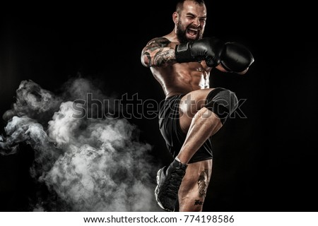 Sportsman boxer fighting on black background with smoke. Copy Space. Sport concept. ストックフォト ©