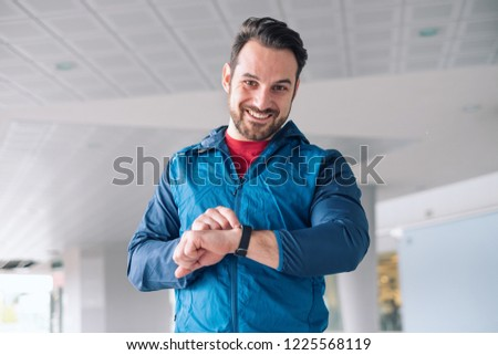 Sportsman checking sportwatch data and personal record