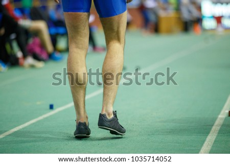 Sportsman getting ready in long jump competition. Track and field competitions concept background #1035714052