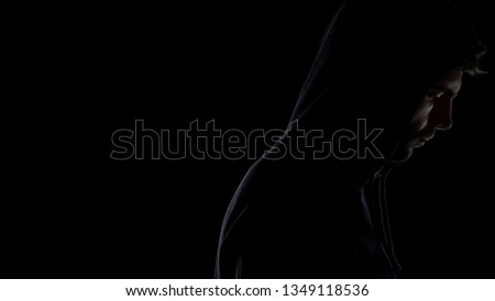 Sportsman in hoodie concentrating before fight, life difficulties, troubles #1349118536