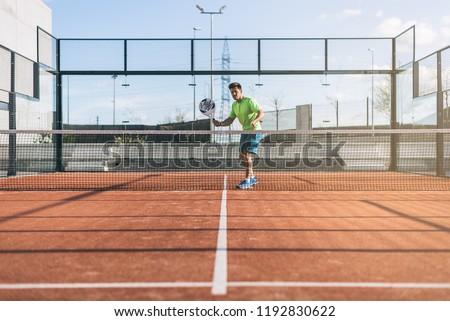 Sportsman playing padel game