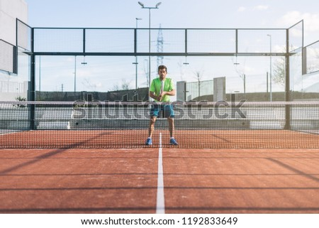 Sportsman playing padel game