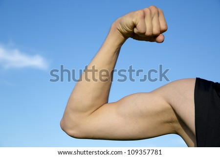 Sportsman show its muscles when strain rihght hand